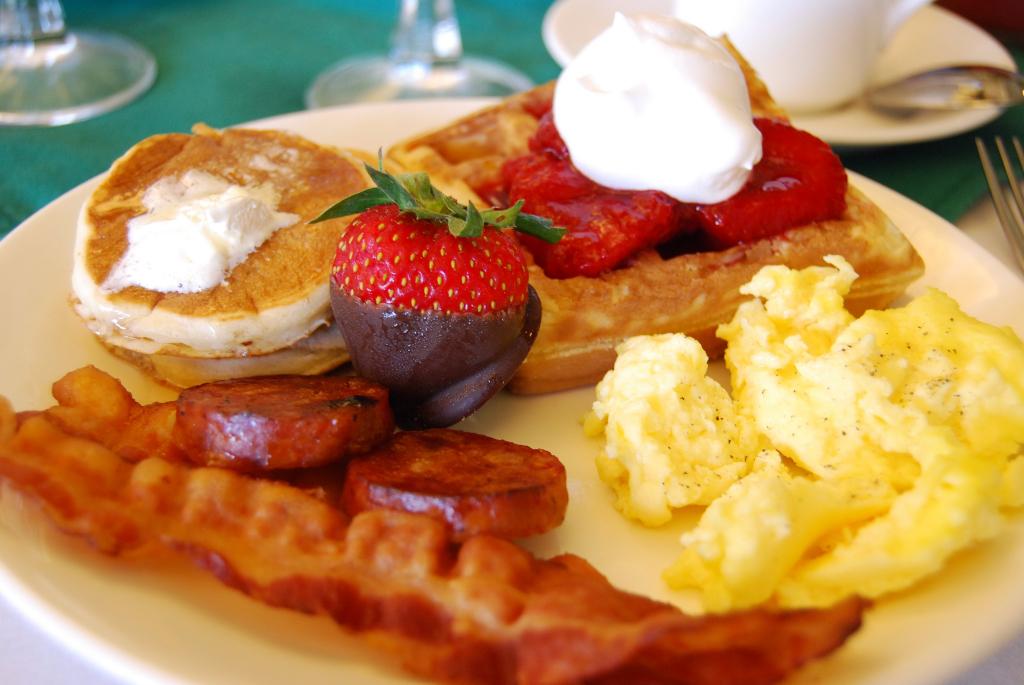 breakfast plate eggs bacon pancakes strawberry