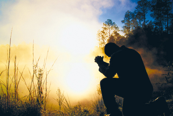 ntcc-kneel-in-prayer